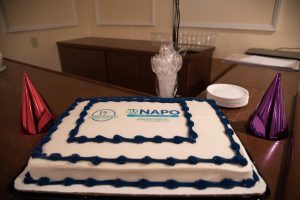 Cake with white frosting and dark blue trim to celebrate NAPO-CT 15 birthday.
