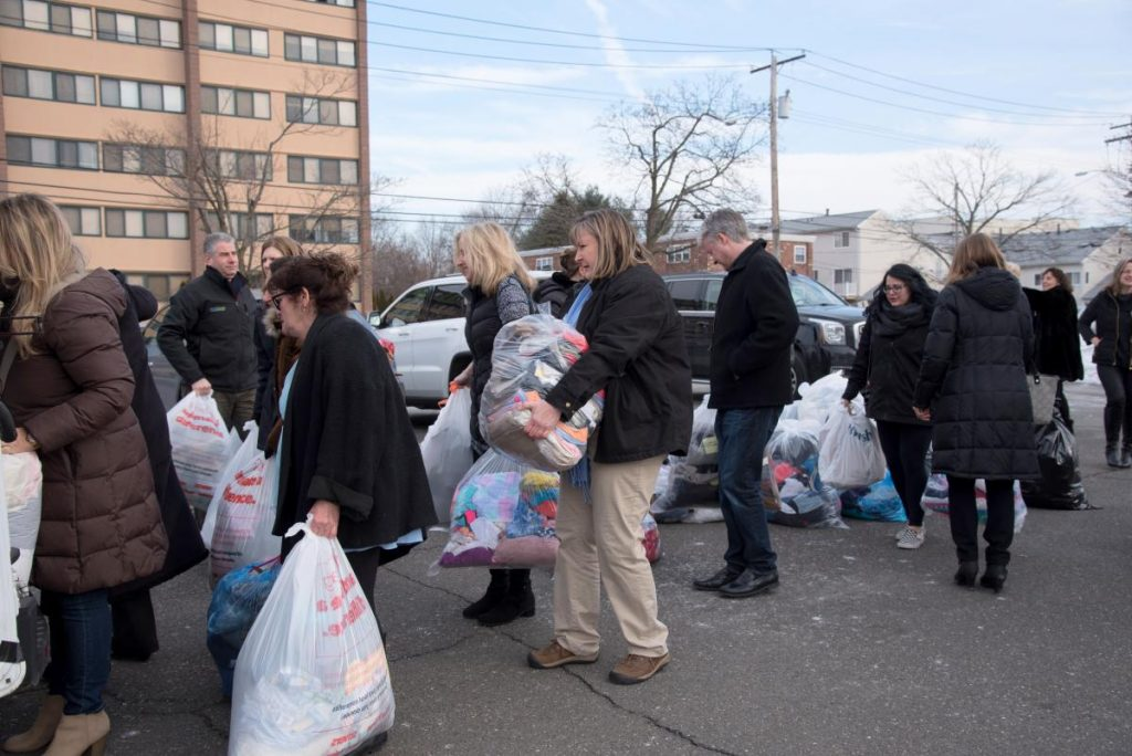 NAPO-CT members move over 200 bags of clothing for GO Month