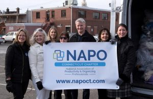 NAPO-CT members holding the new banner during chapter meeting.